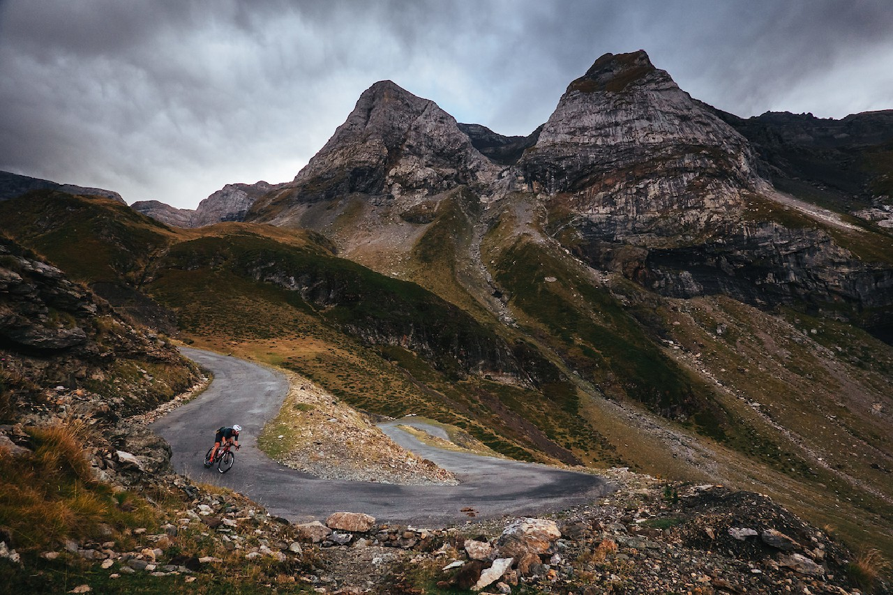 Cyclist riding with mountain background